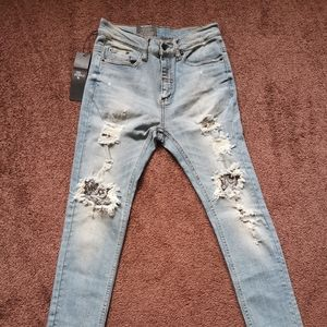 The People VS. 1990 Destroyed jeans faded blue